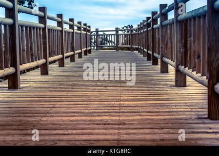 Wooden pathway in the Shireteko Five lakes trail, Hokkaido, Japan - Stock Photo