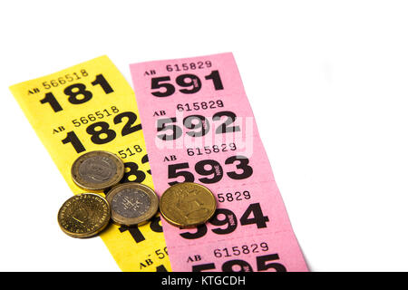 yellow and pink raffle tickets with euro coins with negative space stock photo