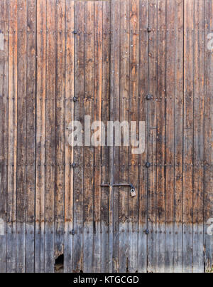 Wooden brown, old and peeled door for backdrop. Close up view with details. Space for text. - Stock Photo