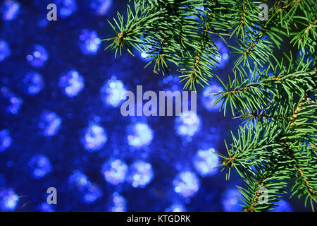 Decorated with colorful balls Christmas tree on a blurry, sparkling and fabulous background. - Stock Photo
