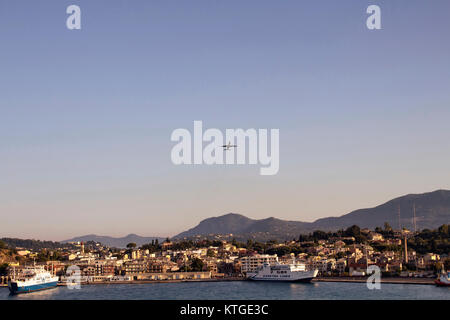 View of airplane over Corfu (Kerkyra) town, cruise ships. It's an island off Greece's northwest coast in the Ionian - Stock Photo