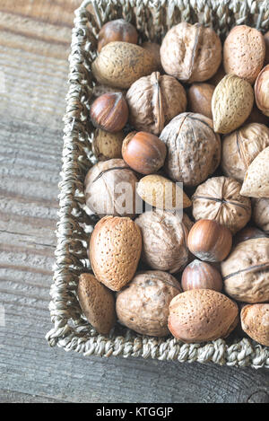 Assortment of nuts in the basket - Stock Photo