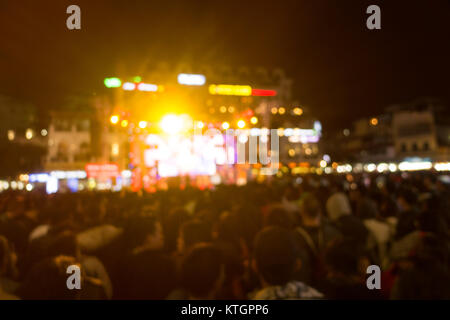 Blurred background: Bokeh lighting and people at music show outdoor on street - Stock Photo