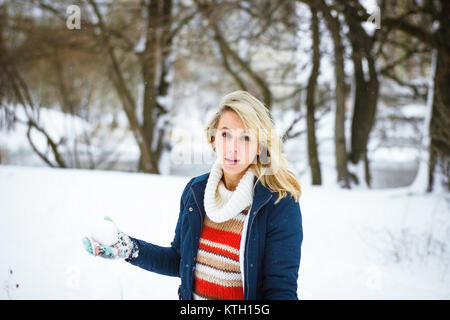 Winter girl play snowballs - Stock Photo