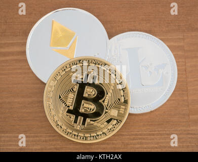 Real coins of different cryptocurrency Bitcoin Ethereum and Litecoin - Stock Photo