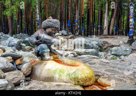 Arshan, Russia - August 16, 2017: Source of mineral water. Water flows from form of figures of boy with jug. Buryatia - Stock Photo