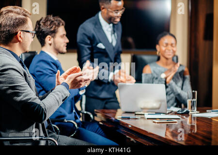 Female team leader on Meeting Discussion Talking in office conference room - Stock Photo