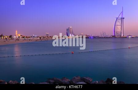 Dubai, UAE, June 7, 2016: view of world's famous Burj Al Arab hotel and Jumeirah Beach at dusk - Stock Photo