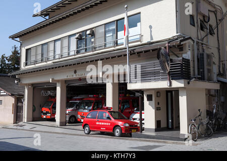 ITSUKUSHIMA, JAPAN-CIRCA APR, 2013: Fire-fighter and ambulance cars are ready to drive on fire alarm. Rescue station - Stock Photo