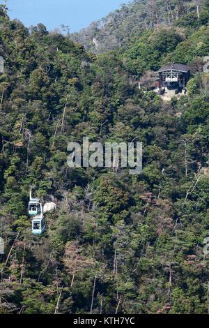 ITSUKUSHIMA, JAPAN-CIRCA APR, 2013: Big aerial tramway comes from the Kayatani stop to the Shishiiwa ropeway station - Stock Photo