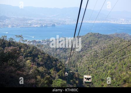 ITSUKUSHIMA, JAPAN-CIRCA APR, 2013: Small gondola lift on the Momijidani line of ropeway to the Kayatani stop and - Stock Photo