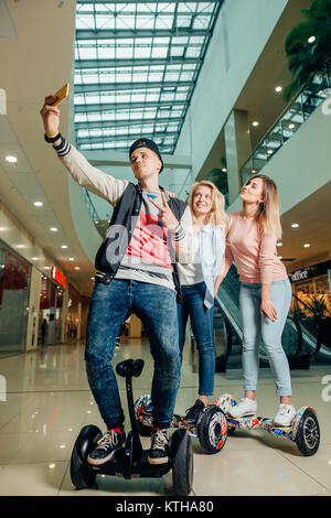 New modern technologies. three people on hoverboard doing selfie - Stock Photo