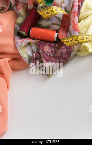 Top view of sewing work table with space for text. Flat lay fashion workspace. Fashion industry concept