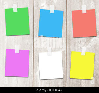 Colored paper sheets for an adhesive tape with copy space for text, notes, and reminders. - Stock Photo