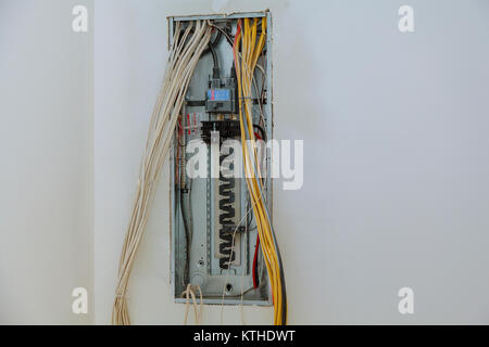 electrical box contains many terminals, relays, wires and switches. installing components in electrical shield - Stock Photo