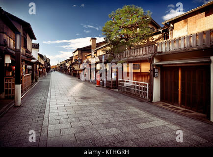 Empty Hanamikoji Dori street in Gion district in morning sunrise with closed shops, restaurants and tea houses built - Stock Photo