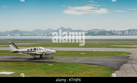 Beechcraft Baron B55 taxiing on the runway in Rio de Janeiro, Brazil - Stock Photo