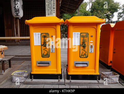 Kyoto, Japan - Dec 25, 2015. Yellow mail boxes at Kinkakuji Pagoda in Kyoto, Japan. Kinkakuji is a Zen temple in - Stock Photo