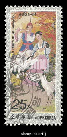 DPR Korea - stamp 1988: Color edition on topic of Fairy Tales, shows Couple with baby - Stock Photo