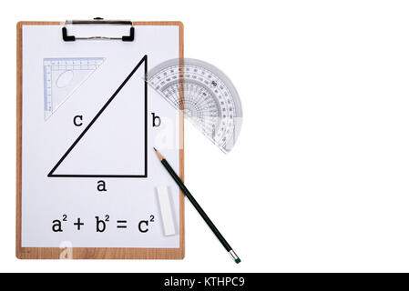 Pythagorean Theorem. Clipboard triangle protractor pencil isolated on the white background. - Stock Photo
