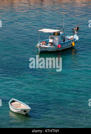Small fishing boats floating at the sea at Akamas peninsula area in Paphos, Cyprus - Stock Photo