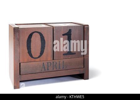 Wooden Perpetual Calendar set to April 1st, April Fools Day - Stock Photo