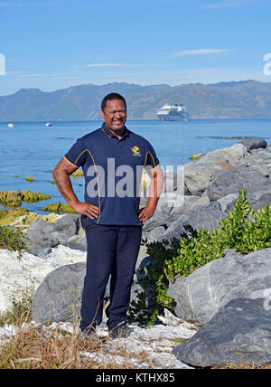 Kaikoura, New Zealand - December 15, 2017: Smiling Whale Watch Kaikoura Staff Member at South Bay Harbour with Cruise - Stock Photo