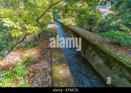 Biwako Sosui canal waterway as It passes along Nanzen-ji Temple. Built in 1890 between Lake Biwa and Kyoto City. - Stock Photo