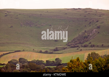 The Long Man of Wilmington, and archaeological site in the Sussex Downs, near Eastbourne England, UK. - Stock Photo