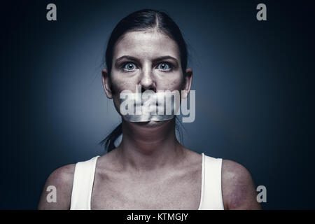 a young girl with a patch on her mouth - Stock Photo