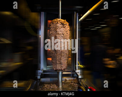 traditional turkish food doner kebab in a street food shop on blur background - Stock Photo