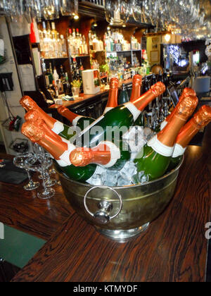 Large bottles of Bucks Fizz chilling in an ice bucket taken in Durham, England, UK - Stock Photo
