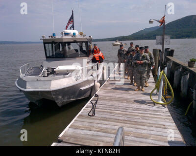 WEST POINT-- New York Guard Search and Rescue Team members debark from New York Naval Militia Patrol Boat 301 during - Stock Photo