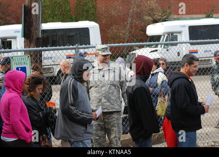LONG BEACH, N.Y. – New York Army National Guard Chaplain (Captain) Brian Pidkaminy greets residents here as Soldiers of the 107th Military Police Company assist the City of Long Beach distribute rations and water provided by the Federal Emergency Management Agency (FEMA) at City Hall Oct. 31.  The arrival of food and water to residents who remained or returned to Long Beach arrives three days after the passage of subtropical storm Sandy on Oct. 29.  The National Guard Soldiers are part of Governor Cuomo's call up of more than 2,400 troops in response to subtropical storm Sandy which struck New
