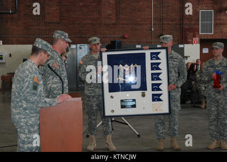 UTICA, N.Y. – Soldiers of the New York Army National Guard's 2nd Battalion, 108th Infantry present a unit gift representing - Stock Photo