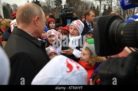 Russian President Vladimir Putin welcomes children for a New Year party in Cathedral Square at the Kremlin December - Stock Photo