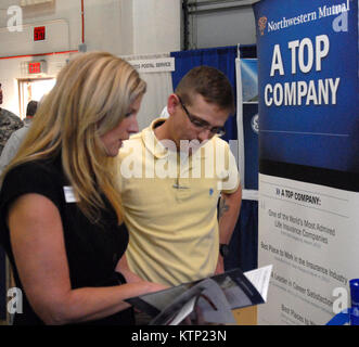 LATHAM, NY – Kristen Cargill, a representative from Northwestern Mutual Financial Network (left) speaks with New - Stock Photo