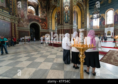 ROSTOV-ON-DON, RUSSIA - CIRCA NOVEMBER 2017: Interior of Orthodox church with different people inside - Stock Photo