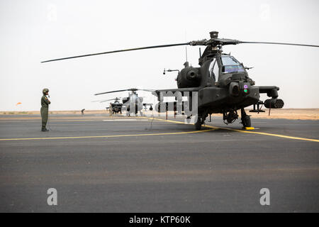 Royal Saudi Land Forces (RSLF) personnel from 1st Battalion, 3rd Aviation Group prepare their AH-64 Apache before - Stock Photo