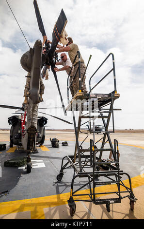 U.S. Army soldiers from 3rd Battalion, 238th General Support Aviation Battalion, 42nd Combat Aviation Brigade, prepare - Stock Photo