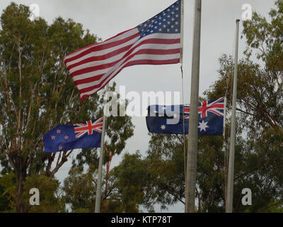 EXMOUTH, Western Australia-- The American flag flies with those of Australia and New Zealand during ANZAC Day celebrations - Stock Photo