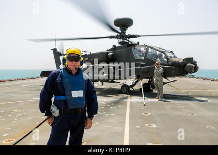 Petty Officer Ian Walker, a deck hand on the RFA Cardigan Bay, Royal Fleet Auxiliary, U.K. Royal Navy, stands in - Stock Photo