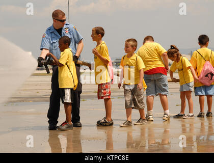 STEWART AIR NATIONAL GUARD BASE - Galaxy Camp students operate a fire hose with a little help from Jason Bartley, - Stock Photo