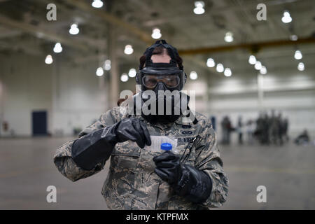 PERRY, GA - Airman First Class Reneee Dillman seals a sample of an unidentified substance for testing during a training - Stock Photo