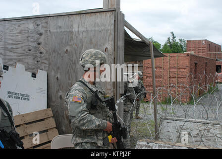 Soldiers from the 102nd Military Police Battalion, Headquarters Detachment from Auburn, conduct detainee operations - Stock Photo