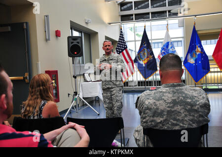 Lt. Col. Dana Brewer addresses the crowd during his retirement ceremony at Latham Headquarters on July 30. (U.S. - Stock Photo