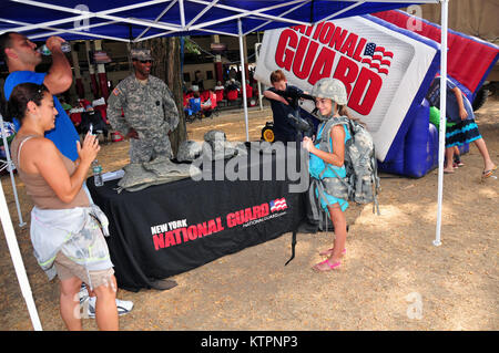 SARATOGA -- Local New York National Guard recruiters talk to attendees at the Saratoga race track on Sept. 2 during - Stock Photo
