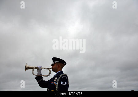 WESTHAMPTON BEACH, NY - Senior Airman Corey Smith, a member of the 106th Honor Guard, practices with the bugle a - Stock Photo