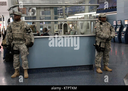 New York Army National Guard Soldiers from Joint Task Force Empire Shield help provide security support at New York - Stock Photo