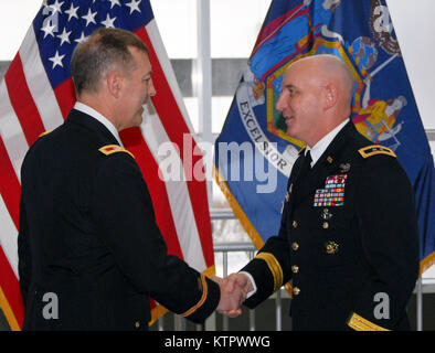 Maj. Gen. Brian J. McKiernan, commanding general of First Army Division East (right), congratulates Col. Kevin L. - Stock Photo